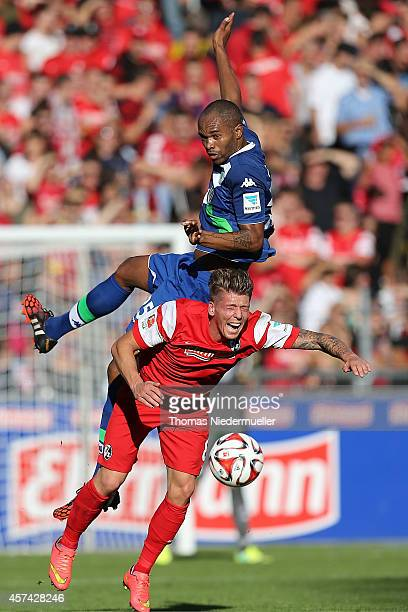 Mike Frantz of Freiburg fights for the ball with Naldo of Wolfsburg during the Bundesliga match between SC Freiburg and VfL Wolfsburg at MAGE SOLAR...