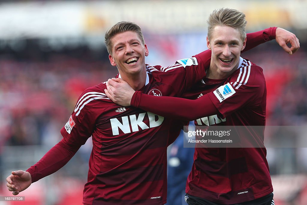 Mike Frantz (L) of Nuernberg celebrates victory with his team mate Sebastian Polter after winning the Bundesliga match between 1. FC Nuernberg and FC Schalke 04 at Grundig-Stadion on March 16, 2013 in Nuremberg, Germany.