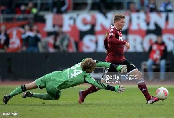 Mike Frantz of Nuernberg scores his team's third goal past goalkeeper Timo Hildebrand of Schalke during the Bundesliga match between 1 FC Nuernberg...
