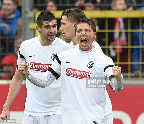 Mike Frantz of SC Freiburg celebrates his opening goal during the Bundesliga match between Sport Club Freiburg and 1 FC Koeln at SchwarzwaldStadium...