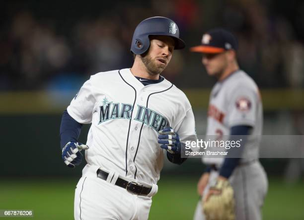 Mike Freeman of the Seattle Mariners rounds the bases after hitting a solo home run off starting pitcher Mike Fiers of the Houston Astros during the...