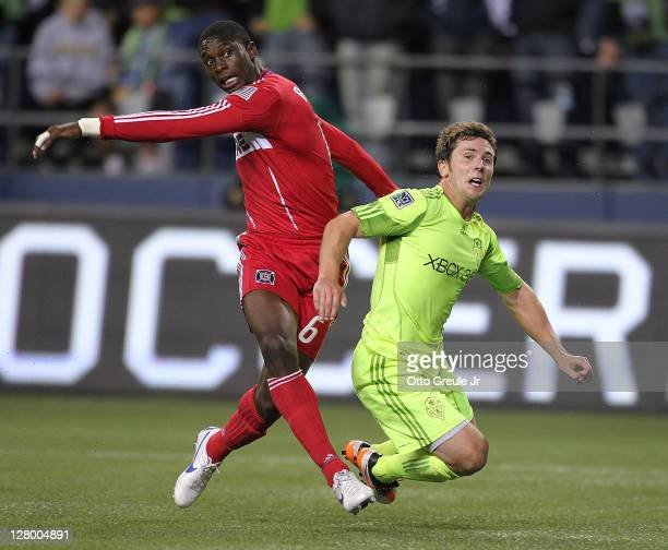 Mike Fucito of the Seattle Sounders FC battles Jalil Anibaba of the Chicago Fire during the 2011 Lamar Hunt US Open Cup Final at CenturyLink Field on...