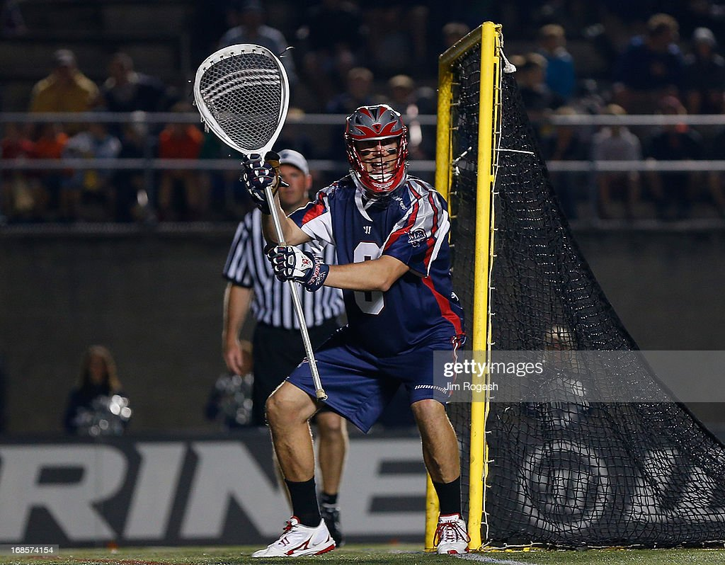Mike Gabel #9 of the Boston Cannons defends the net against the Denver Outlaws in the second half at Harvard Stadium on May 11, 2013 in Boston, Massachusetts.