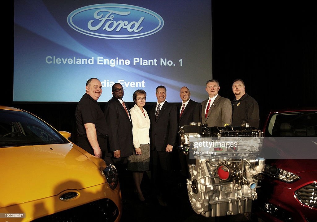 Mike Gammella, local chairman of the United Auto Workers (UAW), from left, Jimmy Settles, vice president of the UAW, U.S. Representative Marcy Kaptur, a Democrat from Ohio, Joe Hinrichs, president of the Americas for Ford Motor Co., Charlie Binger, manager of the Cleveland Engine Plant, Mark Elliott, Mayor of Brook Park, and Pete Johnson, local chairman of the UAW, stand for a photograph with a 2.0 liter ecoboost engine during an event at the Ford Motor Cleveland Engine Plant in Brook Park, Ohio, U.S., on Thursday, February 21, 2013. Ford Motor Co. said it will invest $200 million to make four-cylinder engines at the plant starting in late 2014 as the second-largest U.S. automaker equips an increasing number of models with smaller, more fuel-efficient powertrains. Photographer: David Maxwell/Bloomberg via Getty Images