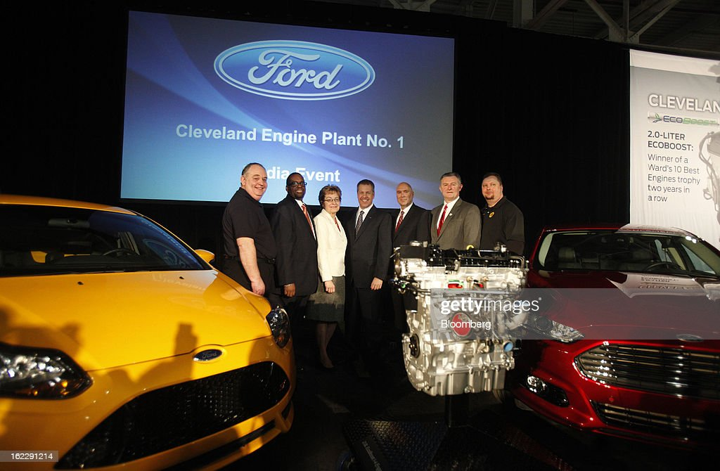 Mike Gammella, local chairman of the United Auto Workers (UAW), from left, Jimmy Settles, vice president of the UAW, U.S. Representative Marcy Kaptur, a Democrat from Ohio, Joe Hinrichs, president of the Americas for Ford Motor Co., Charlie Binger, manager of the Cleveland Engine Plant, Mark Elliott, Mayor of Brook Park, and Pete Johnson, local chairman of the UAW, stand for a photograph with a 2.0 liter ecoboost engine during an event at the Ford Motor Cleveland Engine Plant in Brook Park, Ohio, U.S., on Thursday, Feb. 21, 2013. Ford Motor Co. said it will invest $200 million to make four-cylinder engines at the plant starting in late 2014 as the second-largest U.S. automaker equips an increasing number of models with smaller, more fuel-efficient powertrains. Photographer: David Maxwell/Bloomberg via Getty Images