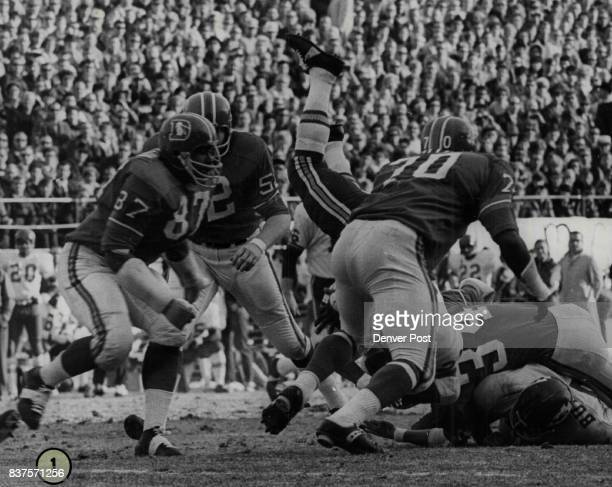 Mike Garrett Kansas City halfback is dealt a jarring tackle by Gus Hollomon and as a result the ball pops loose Denver players are Richard Jackson...
