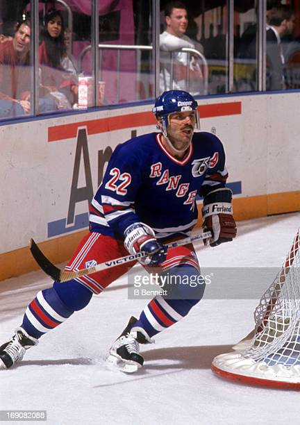 Mike Gartner of the New York Rangers skates around the net during an NHL game against the Vancouver Canucks on February 12 1992 at the Madison Square...