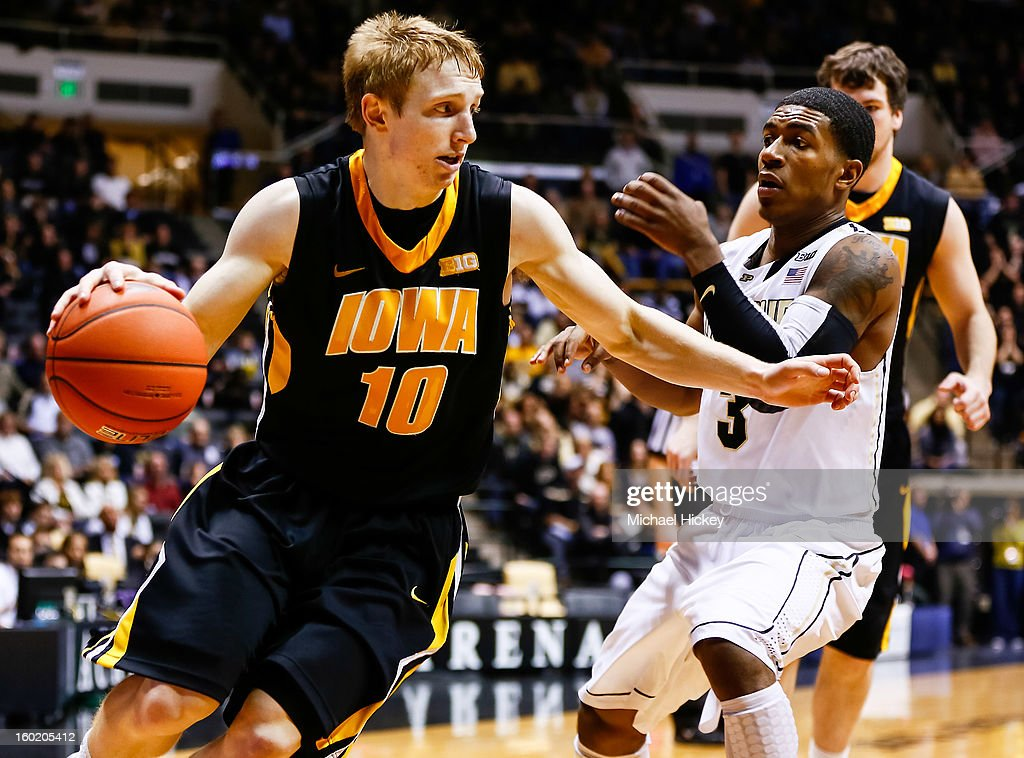 Mike Gesell #10 of the Iowa Hawkeyes dribbles around Ronnie Johnson #3 of the Purdue Boilermakers at Mackey Arena on January 27, 2013 in West Lafayette, Indiana. Purdue defeated Iowa 65-62 in overtime.