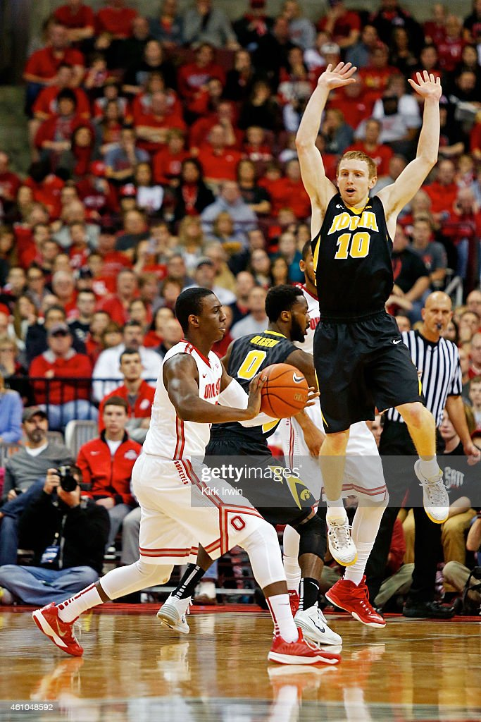 Mike Gesell of the Iowa Hawkeyes guards Shannon Scott of the Ohio State Buckeyes during the game at Value City Arena on December 30 2014 in Columbus...