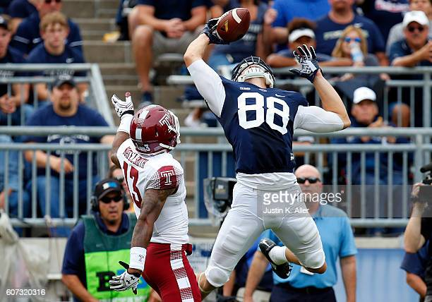 Mike Gesicki of the Penn State Nittany Lions makes a catch against Nate L Smith of the Temple Owls in the second half during the game on September 17...