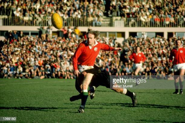 Mike Gibson of the British Lions is tackled during a tour match against the Maoris in Auckland New Zealand Mandatory Credit Adrian Murrell/Allsport