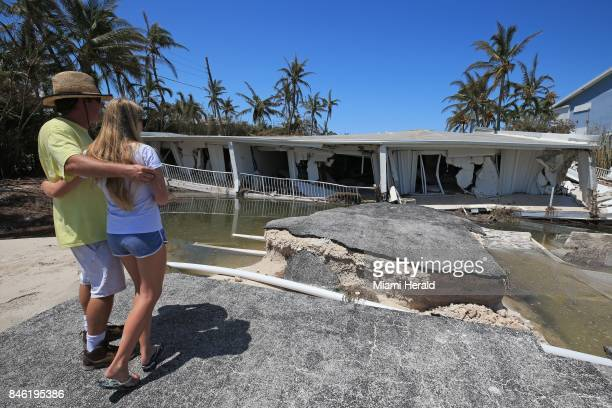 Mike Gilbert and his daughter Brook Gilbert stand over the remnants of a threestory 12unit condominium near Islamorada along the Overseas Highway in...