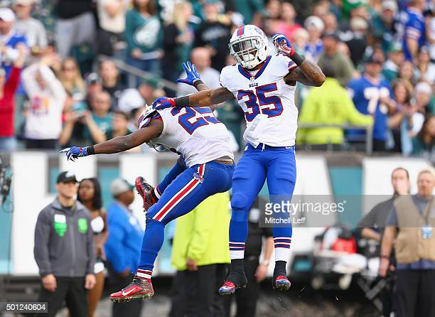 Mike Gillislee of the Buffalo Bills celebrates his touchdown with teammate LeSean McCoy against the Philadelphia Eagles in the third quarter at...