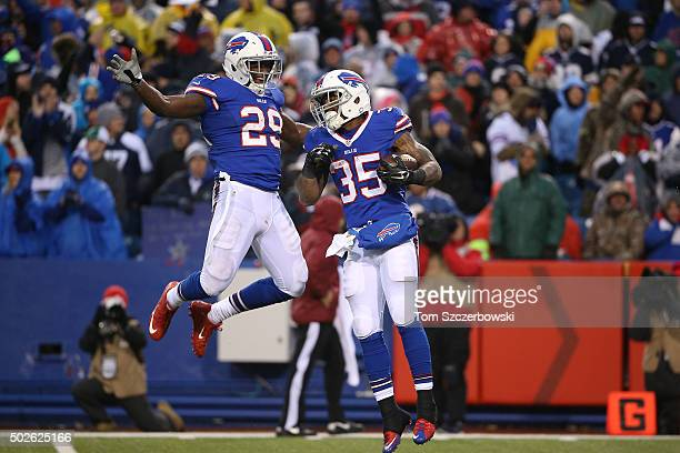 Mike Gillislee of the Buffalo Bills celebrates his touchdown with Karlos Williams of the Buffalo Bills during the second half against the Dallas...
