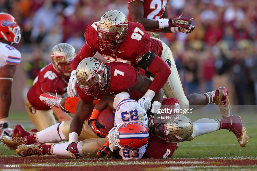 Mike Gillislee #23 of the Florida Gators is tackled during a game against the Florida Gators at Doak Campbell Stadium on November 24, 2012 in Tallahassee, Florida.