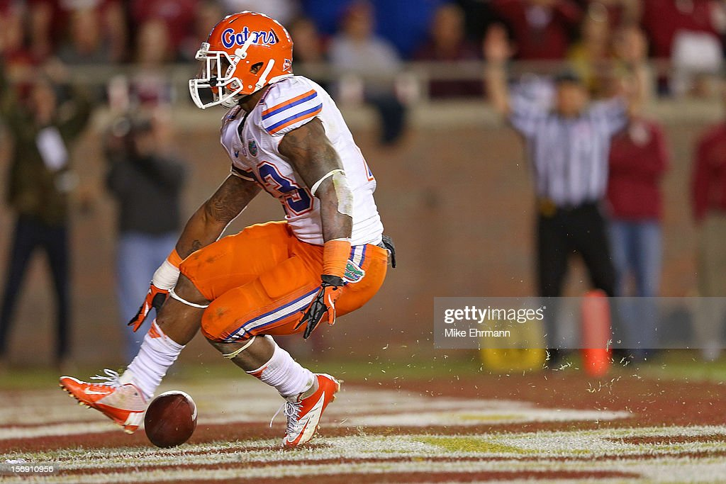 Mike Gillislee #23 of the Florida Gators scores a touchdown during a game against the Florida State Seminoles at Doak Campbell Stadium on November 24, 2012 in Tallahassee, Florida.