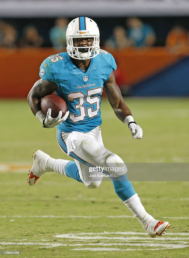 <a gi-track='captionPersonalityLinkClicked' href=/galleries/search?phrase=Mike+Gillislee&family=editorial&specificpeople=7128731 ng-click='$event.stopPropagation()'>Mike Gillislee</a> #35 of the Miami Dolphins runs with the ball against the New Orleans Saints during a preseason game on August 29, 2013 at Sun Life Stadium in Miami Gardens, Florida. The Dolphins defeated the Saints 24-21.