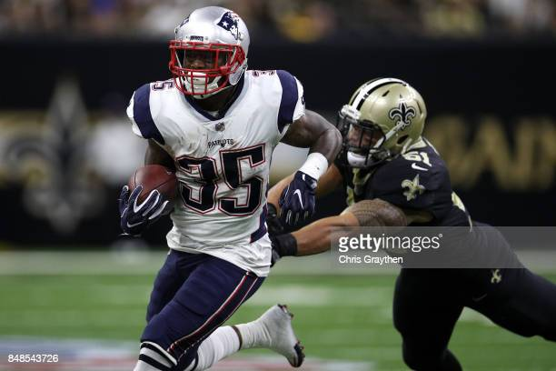 Mike Gillislee of the New England Patriots avoids a tackle by Trey Hendrickson of the New Orleans Saints at the MercedesBenz Superdome on September...