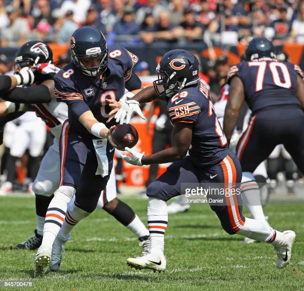 Mike Glennon of the Chicago Bears hands off to Tarik Cohen against the Atlanta Falcons during the season opening game at Soldier Field on September...