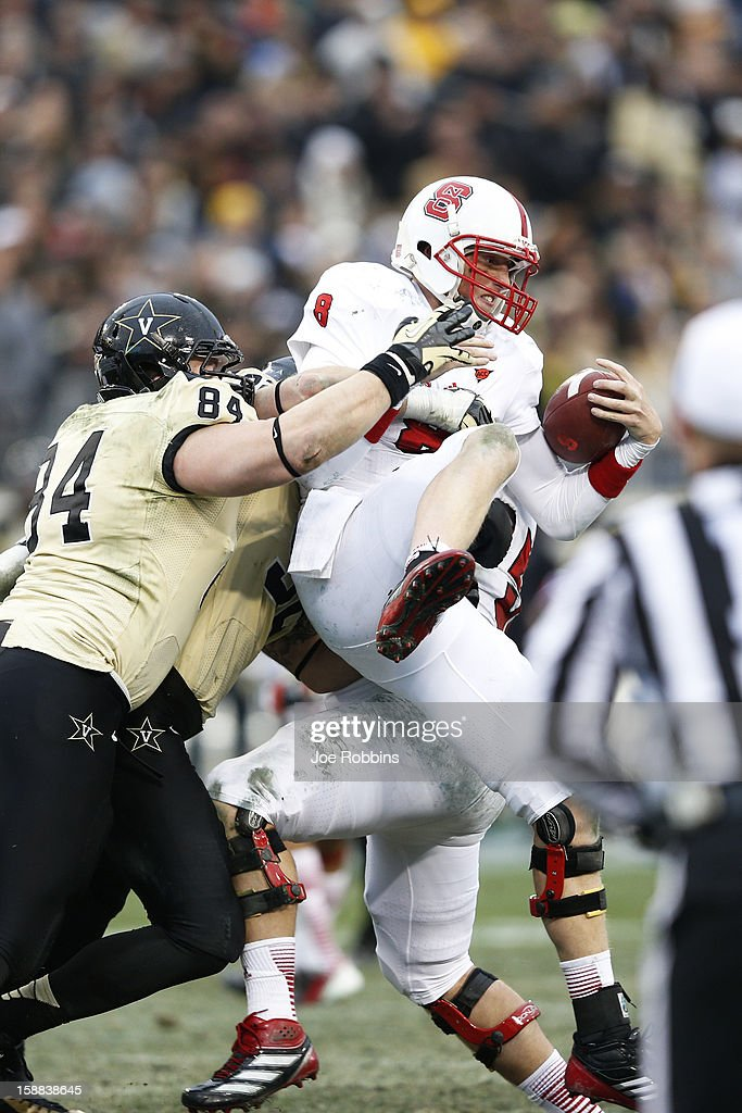 Mike Glennon #8 of the North Carolina State Wolfpack gets sacked by Rob Lohr #84 of the Vanderbilt Commodores during the Franklin American Mortgage Music City Bowl at LP Field on December 31, 2012 in Nashville, Tennessee. Vanderbilt won 38-24.
