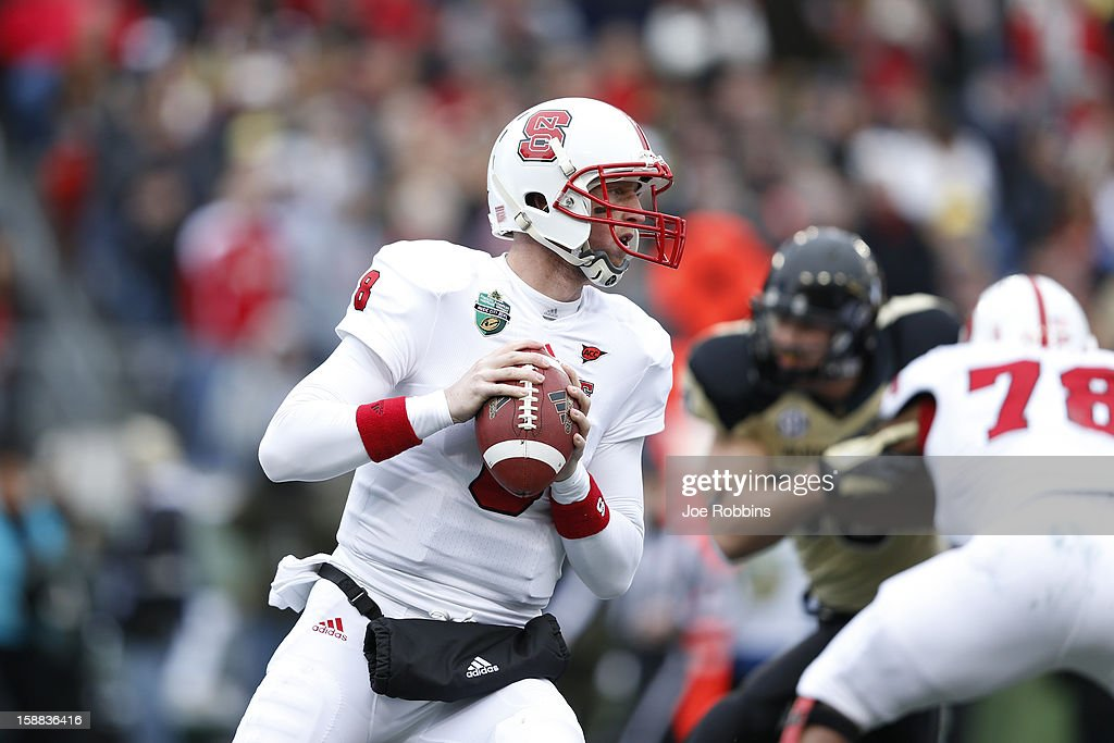 Mike Glennon #8 of the North Carolina State Wolfpack looks to pass the ball against the Vanderbilt Commodores during the Franklin American Mortgage Music City Bowl at LP Field on December 31, 2012 in Nashville, Tennessee.