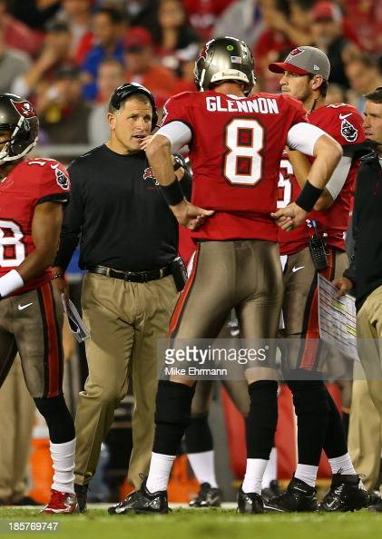 Mike Glennon of the Tampa Bay Buccaneers talks with head coch Greg Schiano during a game against the Carolina Panthers at Raymond James Stadium on...