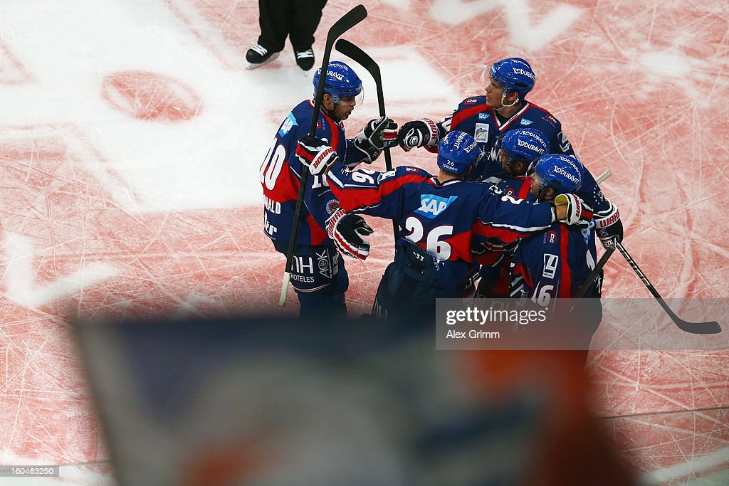 Mike Glumac of Mannheim celebrates his team's first goal with team mates during the DEL match between Adler Mannheim and Eisbaeren Berlin at SAP Arena on February 1, 2013 in Mannheim, Germany.