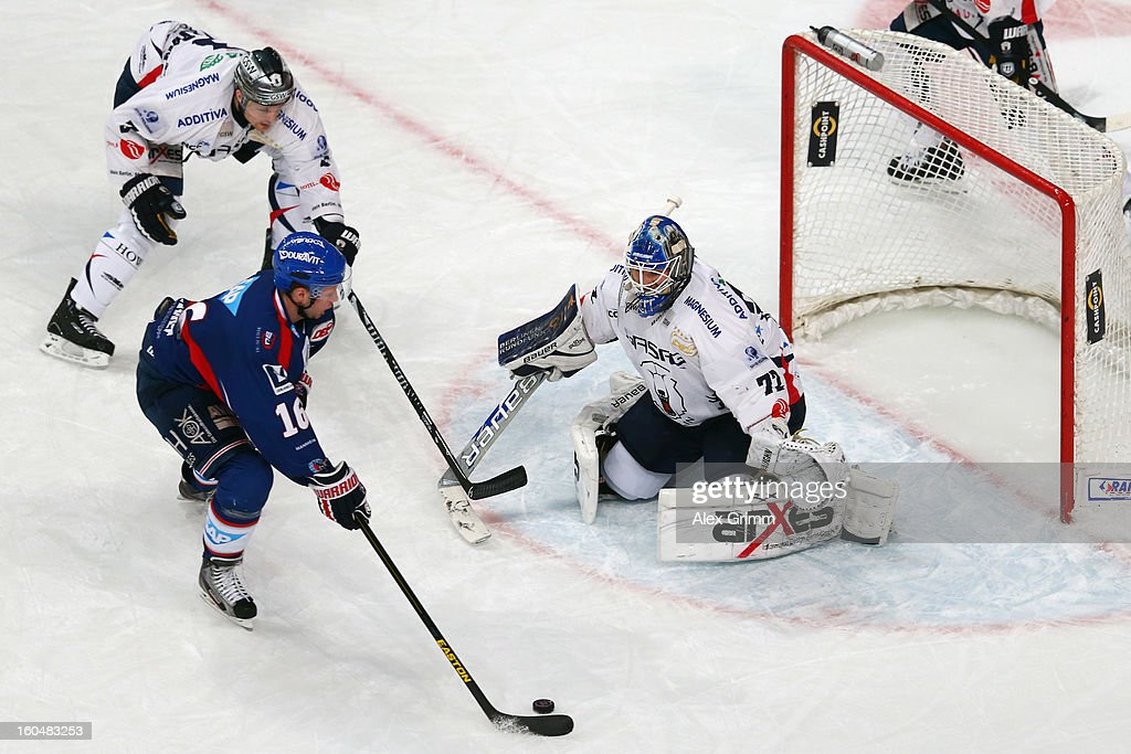 Mike Glumac of Mannheim scores his team's first goal against goalkeeper <a gi-track='captionPersonalityLinkClicked' href=/galleries/search?phrase=Rob+Zepp&family=editorial&specificpeople=3121630 ng-click='$event.stopPropagation()'>Rob Zepp</a> of Berlin during the DEL match between Adler Mannheim and Eisbaeren Berlin at SAP Arena on February 1, 2013 in Mannheim, Germany.