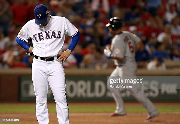 Mike Gonzalez of the Texas Rangers reacts as Albert Pujols of the St Louis Cardinals rounds the bases after hitting a tworun home run in the seventh...