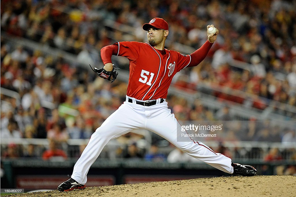 <a gi-track='captionPersonalityLinkClicked' href=/galleries/search?phrase=Mike+Gonzalez&family=editorial&specificpeople=240667 ng-click='$event.stopPropagation()'>Mike Gonzalez</a> #51 of the Washington Nationals throws a pitch against the New York Mets at Nationals Park on August 18, 2012 in Washington, DC.
