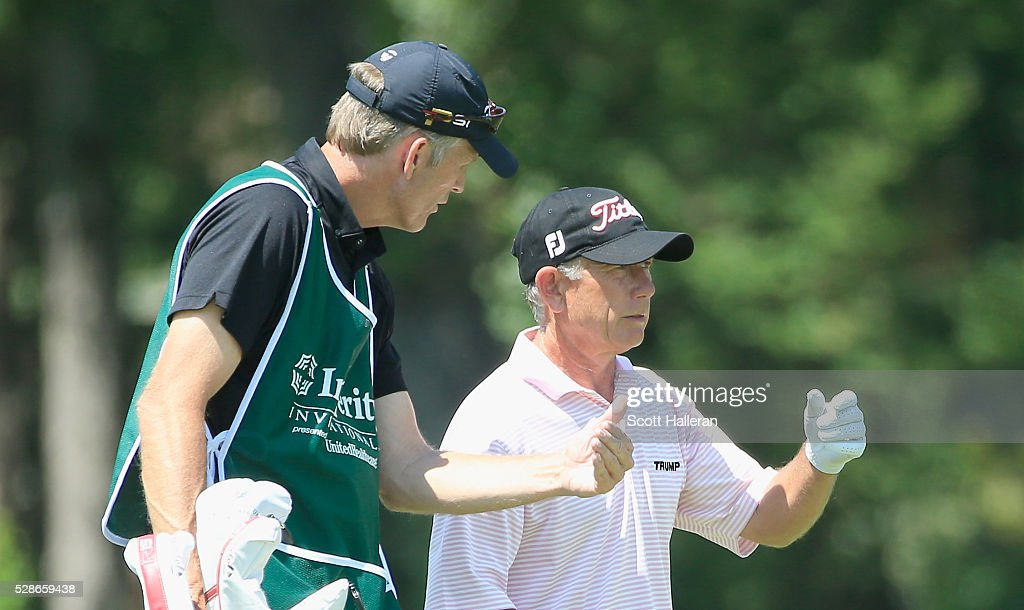 Mike Goodes chats with his caddie on the 17th hole during the first round of the Insperity Championship at The Woodlands Country Club on May 06, 2016 in The Woodlands, Texas.