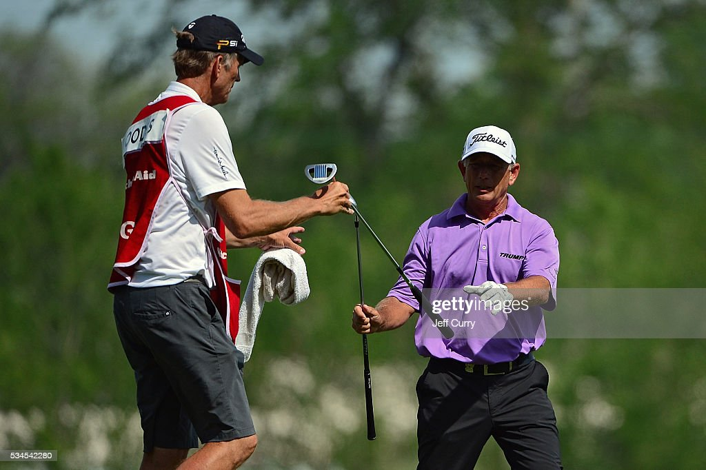 Mike Goodes exchanges clubs with his caddy on the 16th fairway during the first round 2016 Senior PGA Championship presented by KitchenAid at the Golf Club at Harbor Shores on May 26, 2016 in Benton Harbor, Michigan.