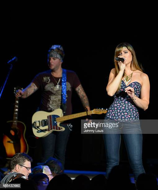 Mike Gossin and Rachel Reinert of Gloriana perform at Cruzan Amphitheatre on September 13 2014 in West Palm Beach Florida