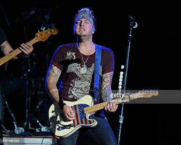 Mike Gossin of Gloriana performs at Cruzan Amphitheatre on September 13 2014 in West Palm Beach Florida