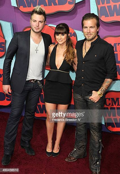 Mike Gossin Rachel Reiner and Tom Gossin of Glorianna attend the red carpet at the 2014 CMT Music awards at the Bridgestone Arena on June 4 2014 in...