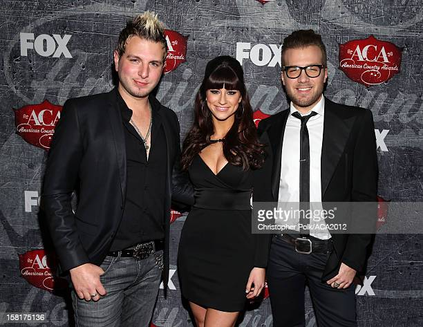 Mike Gossin Rachel Reinert and Tom Gossin of Gloriana arrive at the 2012 American Country Awards at the Mandalay Bay Events Center on December 10...