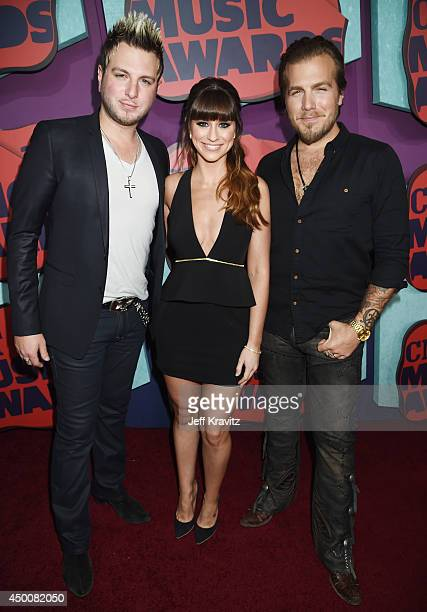 Mike Gossin Rachel Reinert and Tom Gossin of Gloriana attend the 2014 CMT Music awards at the Bridgestone Arena on June 4 2014 in Nashville Tennessee