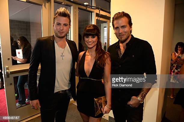 Mike Gossin Rachel Reinert and Tom Gossin of the band Gloriana attend the 2014 CMT Music Awards at Bridgestone Arena on June 4 2014 in Nashville...