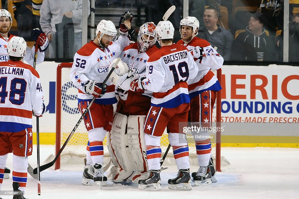Mike Green #52, <a gi-track='captionPersonalityLinkClicked' href=/galleries/search?phrase=Braden+Holtby&family=editorial&specificpeople=5370964 ng-click='$event.stopPropagation()'>Braden Holtby</a> #70, Nicklas Backstrom #19, and <a gi-track='captionPersonalityLinkClicked' href=/galleries/search?phrase=Brooks+Laich&family=editorial&specificpeople=554432 ng-click='$event.stopPropagation()'>Brooks Laich</a> #21 of the Washington Capitals celebrate a game win against the Boston Bruins at the TD Garden on March 1, 2014 in Boston, Massachusetts.
