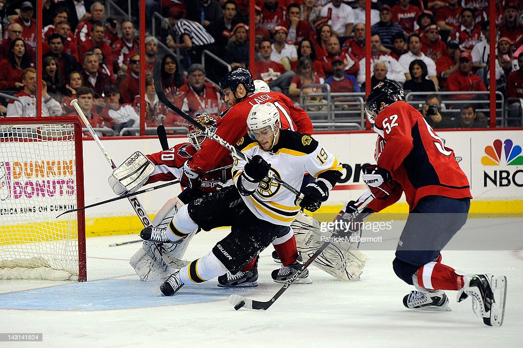 Mike Green #52, <a gi-track='captionPersonalityLinkClicked' href=/galleries/search?phrase=Brooks+Laich&family=editorial&specificpeople=554432 ng-click='$event.stopPropagation()'>Brooks Laich</a> #21, and Braden Holtby #70 of the Washington Capitals battle for the puck with <a gi-track='captionPersonalityLinkClicked' href=/galleries/search?phrase=Tyler+Seguin&family=editorial&specificpeople=6698848 ng-click='$event.stopPropagation()'>Tyler Seguin</a> #19 of the Boston Bruins in Game Four of the Eastern Conference Quarterfinals during the 2012 NHL Stanley Cup Playoffs at Verizon Center on April 19, 2012 in Washington, DC.