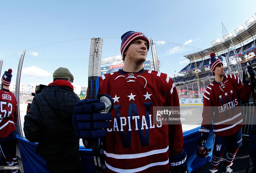 Mike Green #52, John Carlson #74 and Matt Niskanen #2 of the Washington Capitals wait to take the ice for practice prior to the 2015 Bridgestone NHL Winter Classic on December 31, 2014 in Washington, D.C. The 2015 Bridgestone NHL Winter Classic will take place on New Year's Day with the Washington Capitals playing the Chicago Blackhawks.