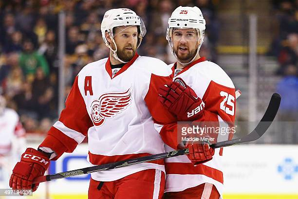 Mike Green of the Detroit Red Wings and Niklas Kronwall talk during the second period against the Boston Bruins at TD Garden on November 14 2015 in...