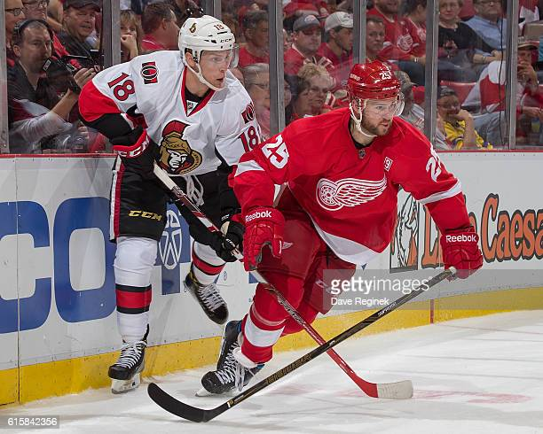 Mike Green of the Detroit Red Wings battles behind the net with Ryan Dzingel of the Ottawa Senators during an NHL game at Joe Louis Arena on October...