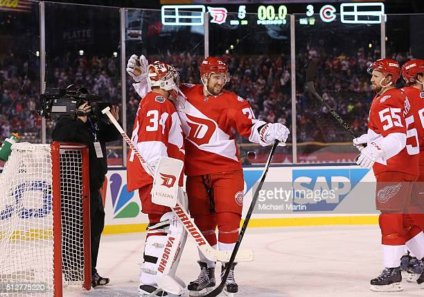 Mike Green of the Detroit Red Wings celebrates a win against the Colorado Avalanche with Goaltender Petr Mrazek at the 2016 Coors Light NHL Stadium...