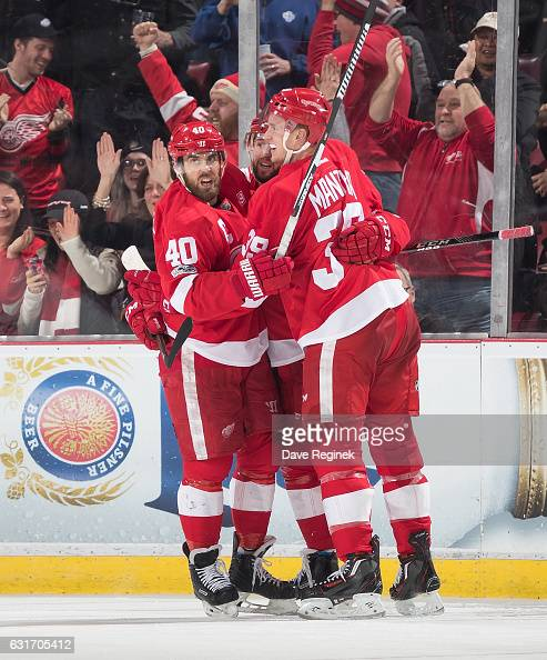 Mike Green of the Detroit Red Wings celebrates his third period goal with teammates Henrik Zetterberg and Anthony Mantha during an NHL game against...