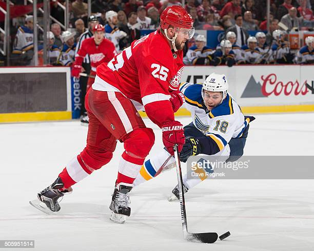 Mike Green of the Detroit Red Wings controls the puck in front of Ty Rattie of the St Louis Blues during an NHL game at Joe Louis Arena on January 20...