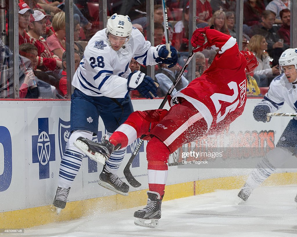 Mike Green #25 of the Detroit Red Wings is checked behind the net by <a gi-track='captionPersonalityLinkClicked' href=/galleries/search?phrase=Colton+Orr&family=editorial&specificpeople=581689 ng-click='$event.stopPropagation()'>Colton Orr</a> #28 of the Toronto Maple Leafs during an NHL game at Joe Louis Arena on October 9, 2015 in Detroit, Michigan.