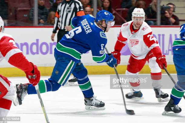 Mike Green of the Detroit Red Wings looks on as Brock Boeser of the Vancouver Canucks takes a shot during their NHL game at Rogers Arena November 6...