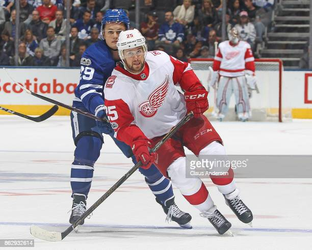 Mike Green of the Detroit Red Wings skates against William Nylander of the Toronto Maple Leafs in an NHL game at the Air Canada Centre on October 18...