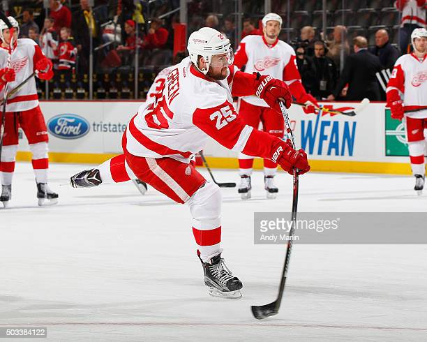 Mike Green of the Detroit Red Wings takes a shot during pregame warmups prior to the game against the New Jersey Devils during the game at the...